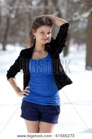 Beautiful girl in the shorts in early spring