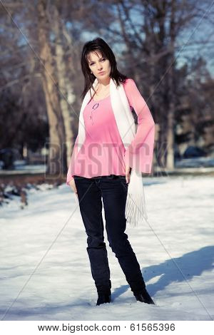 Beautiful girl in a pink blouse in the alley