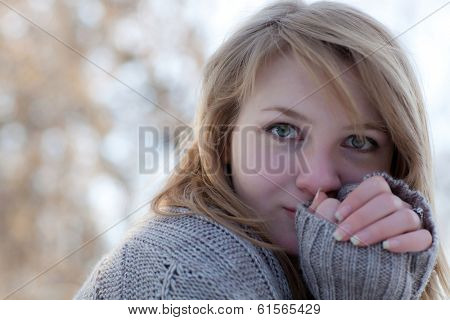Woman freezes in the cold