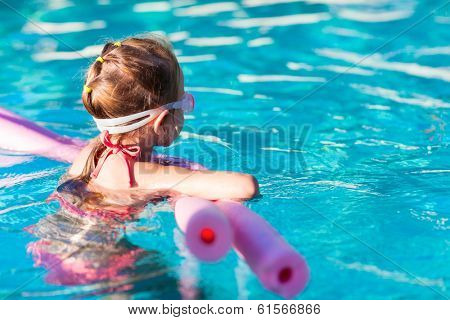 Adorable little girl at swimming pool
