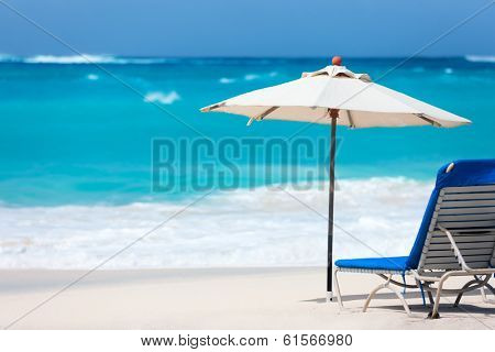 Chairs and umbrella on a beautiful tropical beach at Anguilla, Caribbean