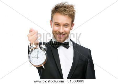 Half-length portrait of businessman holding alarm clock, isolated on white