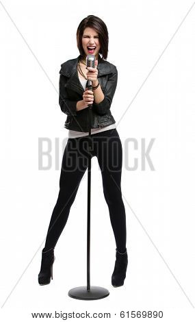 Full-length portrait of rock singer wearing leather jacket and keeping static mic, isolated on white. Concept of rock music and rave