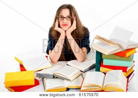 Young Girl Don't Want To Study, She Is Tired, Siting In Surrounding Of Colorful Books With Unhappy F