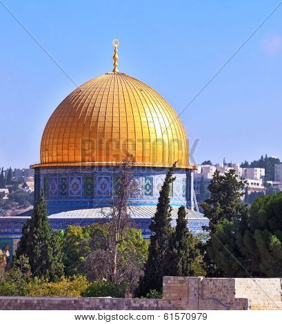 Golden Dome Mosque of Caliph Omar. The Holy City of Jerusalem is lit by the morning sun.