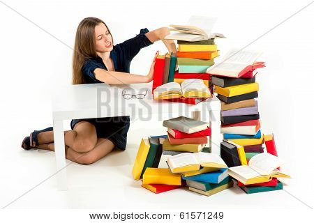 Girl Don't Want To Study And Learn, She Is Pushing Away From Herself A Stack Of Books