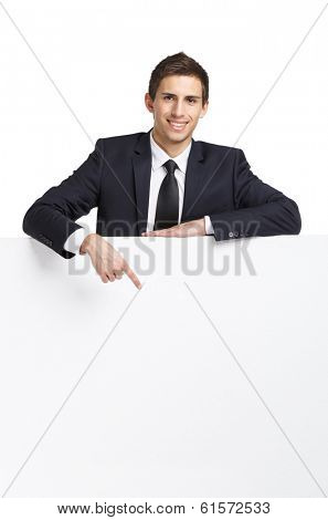 Businessman pointing hand gestures at copyspace, isolated on white. Concept of success and advertisement