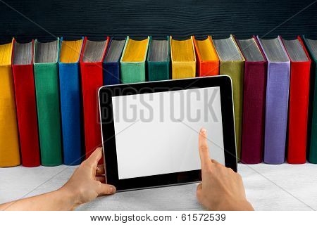 Reading On The Tablet  With Colorful Books On Background
