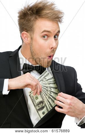 Half-length portrait of businessman hiding dollars, isolated on white. Concept of wealth and income