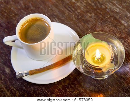 Coffee And  Cinnamon With Candle On Table