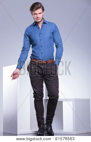 smart casual dressed man in a fashion pose, full body picture in studio