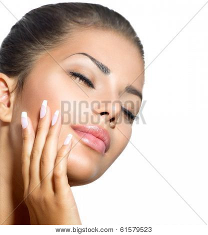 Beauty Spa Woman Portrait. Beautiful Girl Touching her Face.