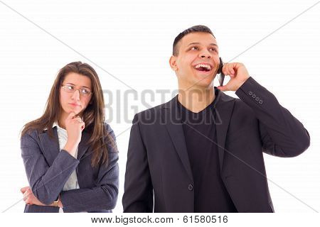 Jealous Woman Looking At Her Man Talking On The Phone