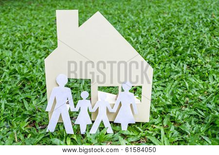 House And Family On Geen Field