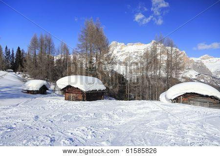 three snowy hovel