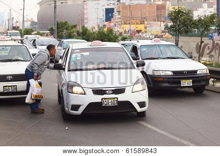 Asking for Taxi Fare in Lima, Peru
