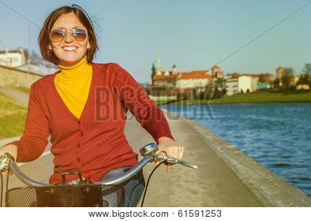 Happy Woman Riding By Bysicle Along The Waterfront
