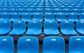 stock photo of grandstand  - Empty plastic chairs of blue color on stadium grandstand - JPG