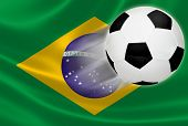 stock photo of brasilia  - Soccer ball flying out of the Brazilian flag in anticipation of 2014 World Cup - JPG