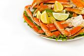 picture of cooked crab  - Snow Crab legs with fresh lemon slices - JPG