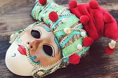 pic of venice carnival  - Beautiful venetian masquerade mask in a red hat for the carnival in Venice - JPG