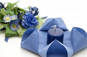 Blue Napkin with Candle and Flower