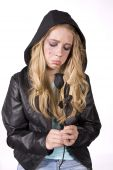 image of pouty lips  - sad girl in a black jacket looking down at a black rose - JPG