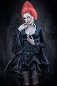 stock photo of gothic hair  - Girl with red hair in the Gothic style - JPG