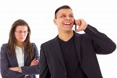 stock photo of envy  - angry jealous woman suspecting on infidelity while her man is talking on the phone - JPG