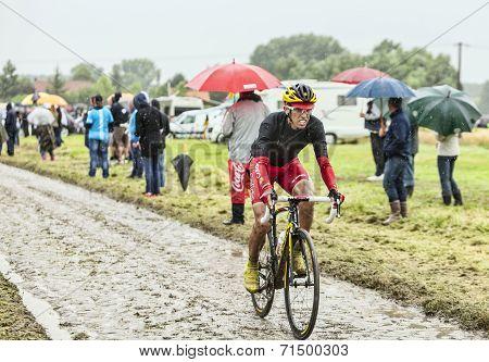 The Cyclist Daniel Navarro Garcia On A Cobbled Road - Tour De France 2014