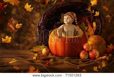 Autumn Baby Pumpkin. Little Kid Artistic Portrait In Children Woolen Hat