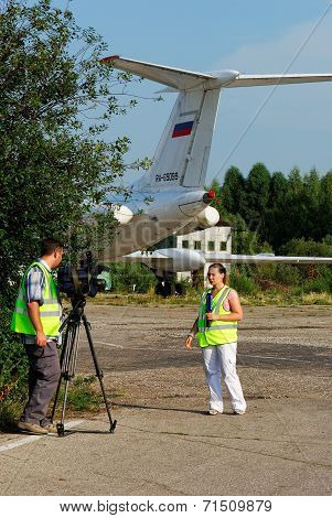 NIZHNY NOVGOROD. RUSSIA. JULY 31, 2014. STRIGINO AIRPORT.Journalists write down the reporting.