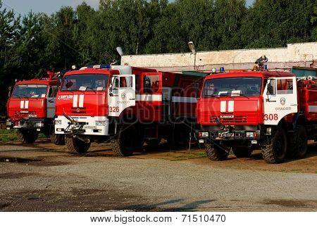 NIZHNY NOVGOROD. RUSSIA. JULY 31, 2014. STRIGINO AIRPORT.fire trucks before hangars