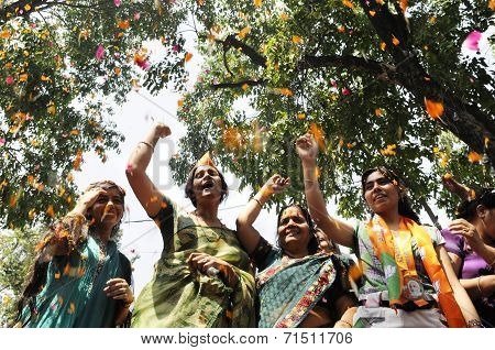 Women celebrating BJP win.