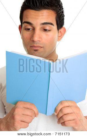 Closeup Of A Man Reading A Book