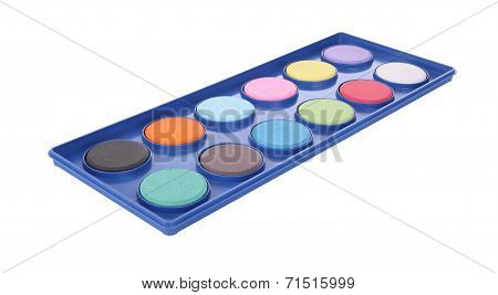 Powder color palette plastic tray on white background.