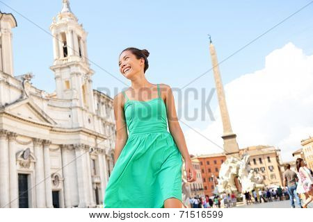 Woman in green dress in Rome on Piazza Navona. Young tourist on vacation travel smiling happy walking joyful in Italy, Europe.