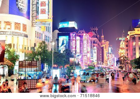 SHANGHAI, CHINA - MAY 28: Nanjing Road street night view on May 28, 2012 in Shanghai, China. Nanjing Road is 6km long as the world's longest shopping district with 1M visitors daily.