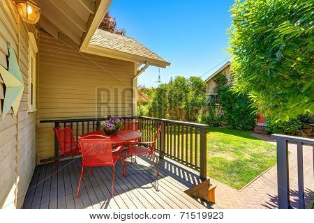 Walkout Deck With Red Table And Chairs