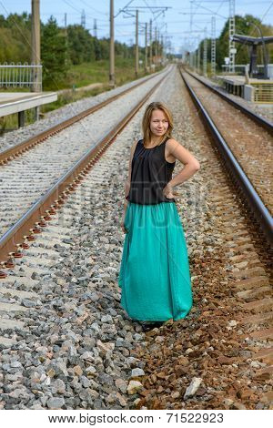 Standing girl between two railway path