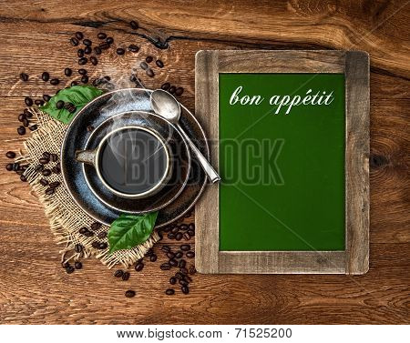Cup Of Coffee And Antique Blackboard