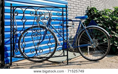 City bicycle fixed gear and blue wall, vintage bike. Retro stylish cycling in town