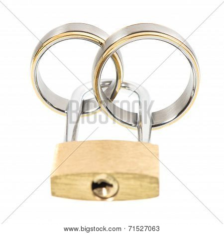 Wedding Rings And Key Lock Over White