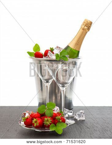 Bottle Of Champagne And Two Glasses Over White Background