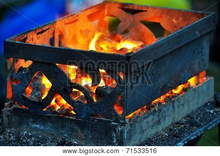 wrought iron box with hot coals
