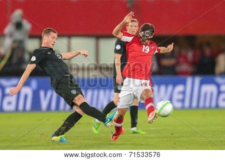 VIENNA, AUSTRIA - SEPTEMBER 10 ames McCarthy (#8 Ireland) and Veli Kavlak (#19 Austria) fight for the ball at a World Cup Qualifying game on September 10, 2013 in Vienna, Austria.