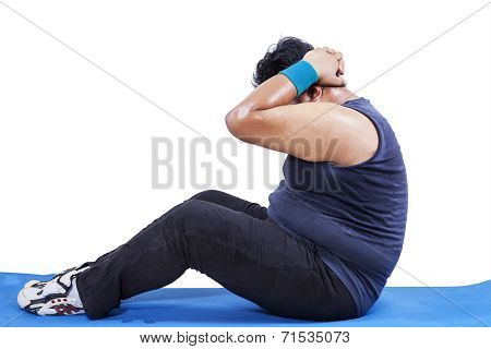 Overweight Man Doing Sit-up