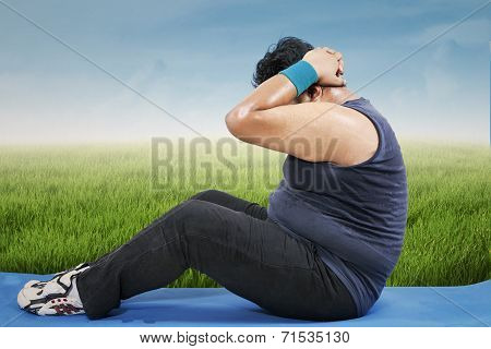 Overweight Man Workout Outdoors