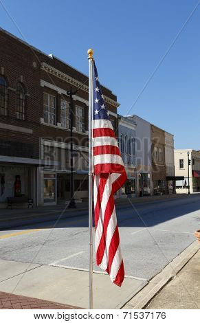American Flag Displayed Along Main Street