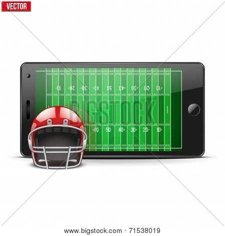 Mobile phone with football helmet and field on the screen.